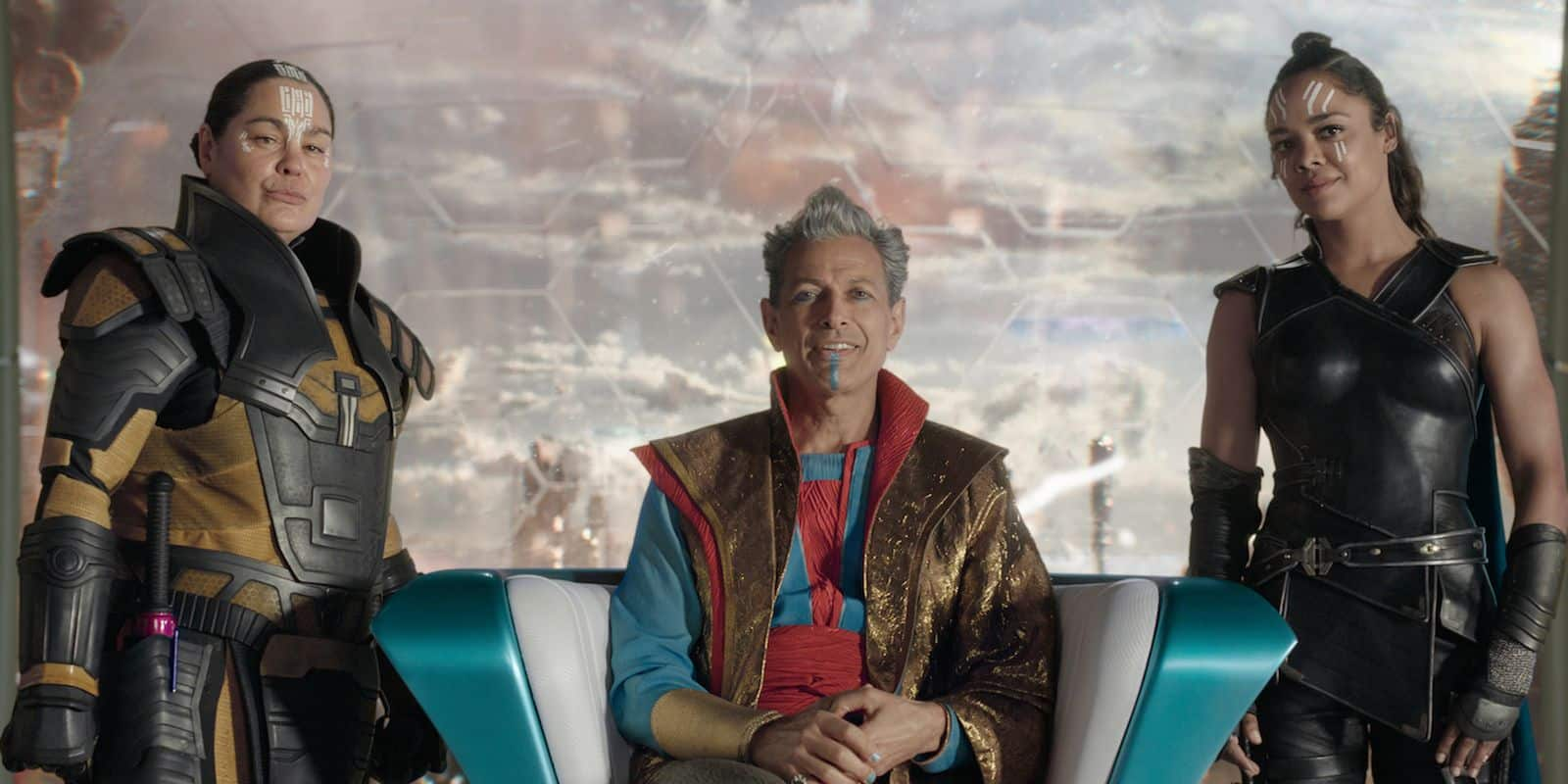 Topaz, Grandmaster, and Valkyrie look at the recently captured Thor